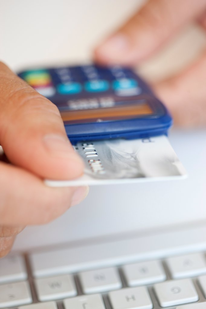 Man Inserting Credit Card into a Card Reader : Stock Photo