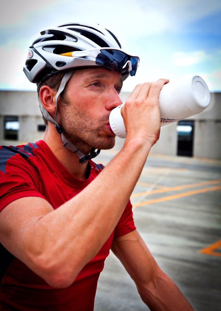 Stock Photo: 4278-9563 Cyclist Drinking Water