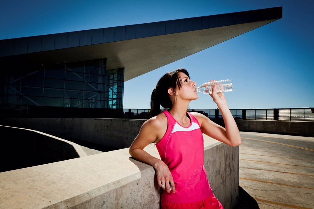 Stock Photo: 4278-9565 Young Woman in Sportswear Drinking Water