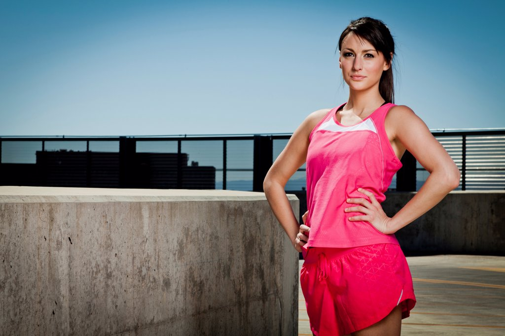 Stock Photo: 4278-9567 Young Woman in Sportswear with Hands on Hips