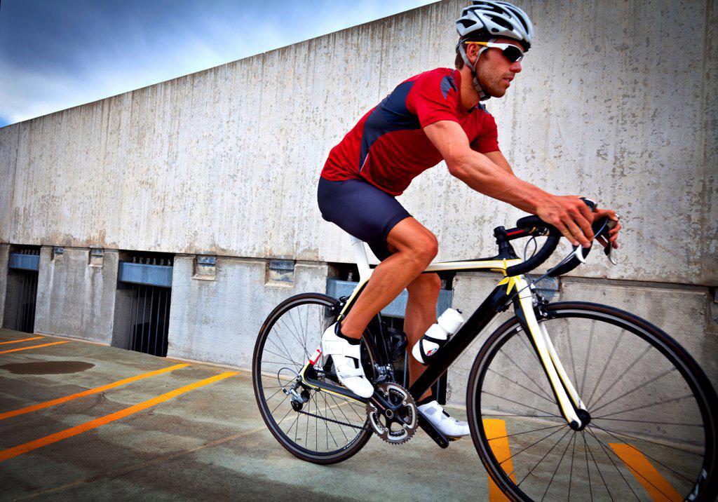 Stock Photo: 4278-9570 Cyclist Riding Bike