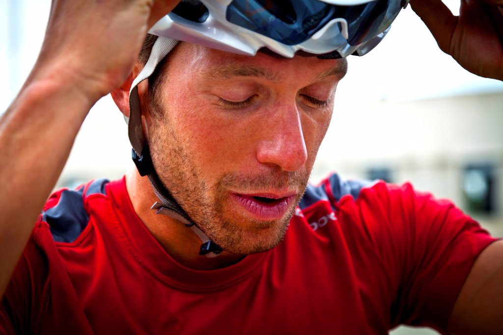 Stock Photo: 4278-9579 Close up of Cyclist with Arms Raised
