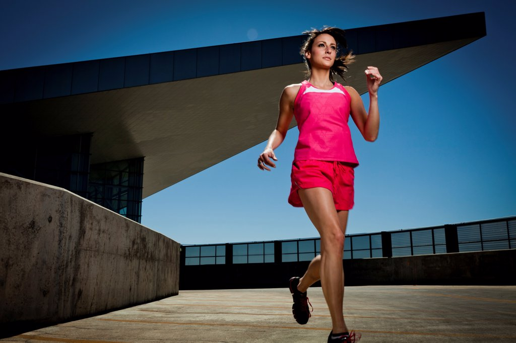 Stock Photo: 4278-9582 Young Woman Running Outdoors