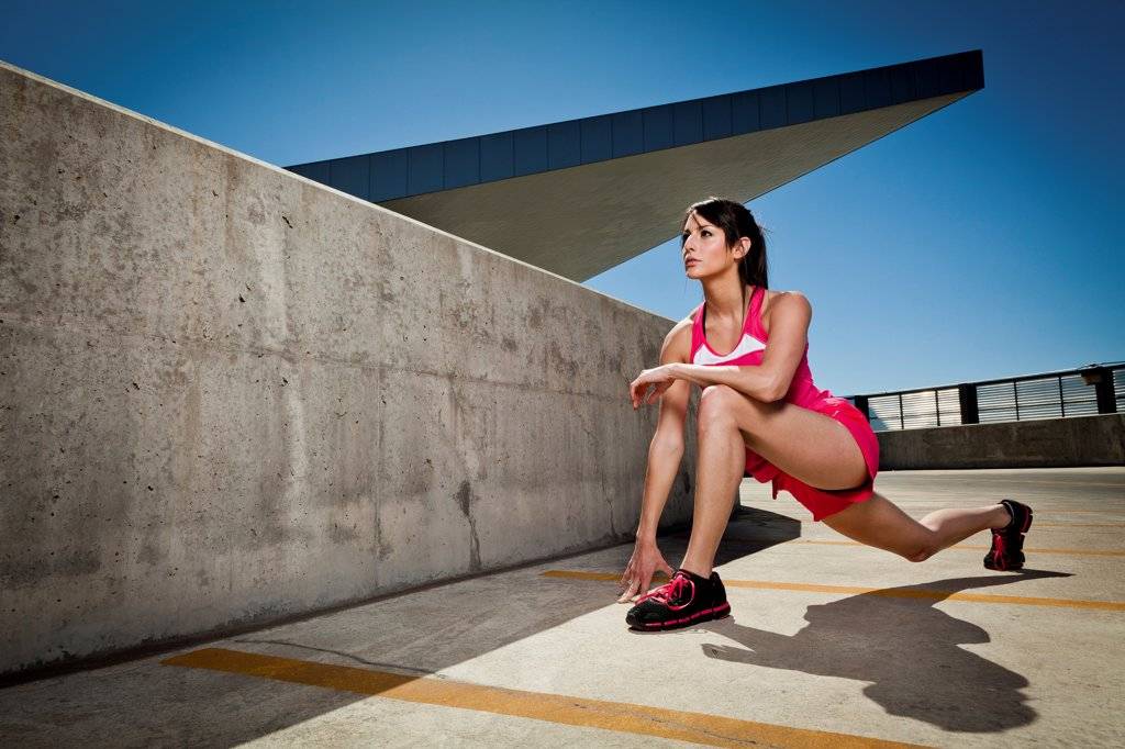 Young Woman Stretching Outdoors : Stock Photo