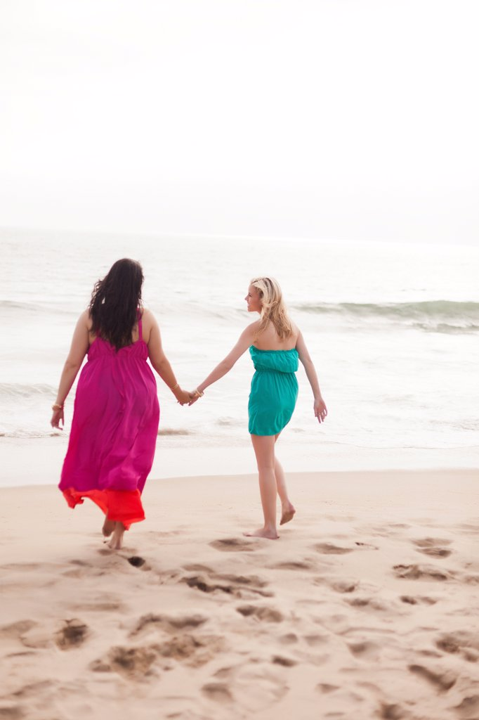 Back View of Two Women Walking on Beach : Stock Photo