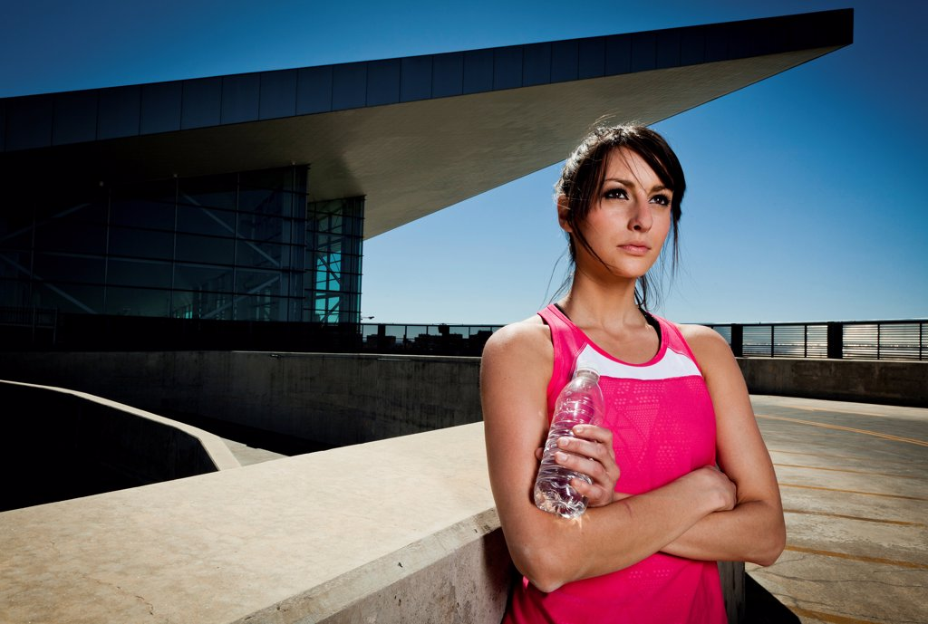 Young Woman in Sportswear with Bottle of Water : Stock Photo