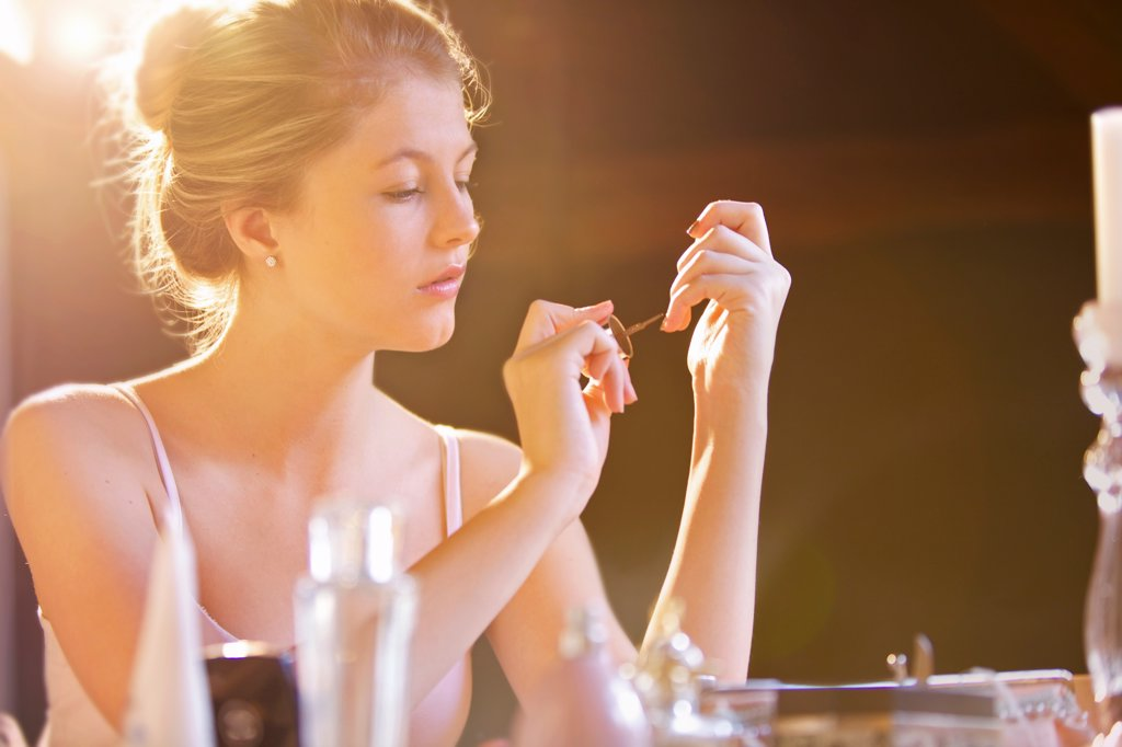 Stock Photo: 4278-9626 Young Woman Applying Nail Polish