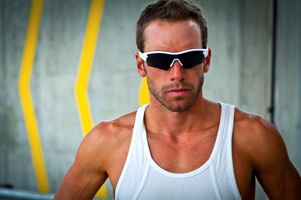Stock Photo: 4278-9635 Portrait of Sportsman with Sunglasses