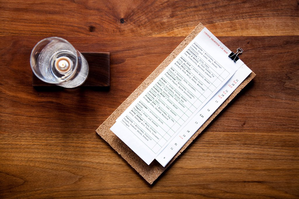Stock Photo: 4278-9637 Menu and Candleholder on Wooden Table