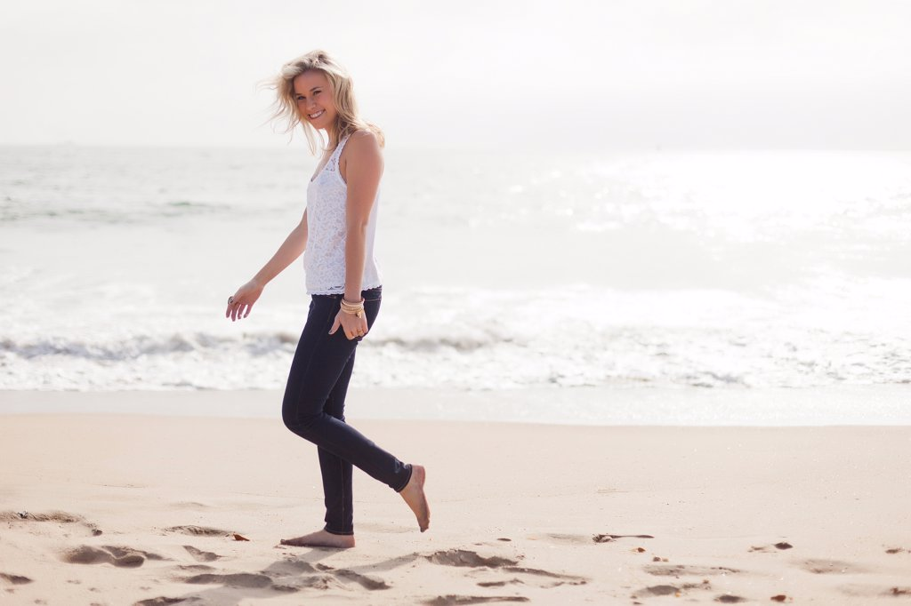 Woman Walking on Beach : Stock Photo