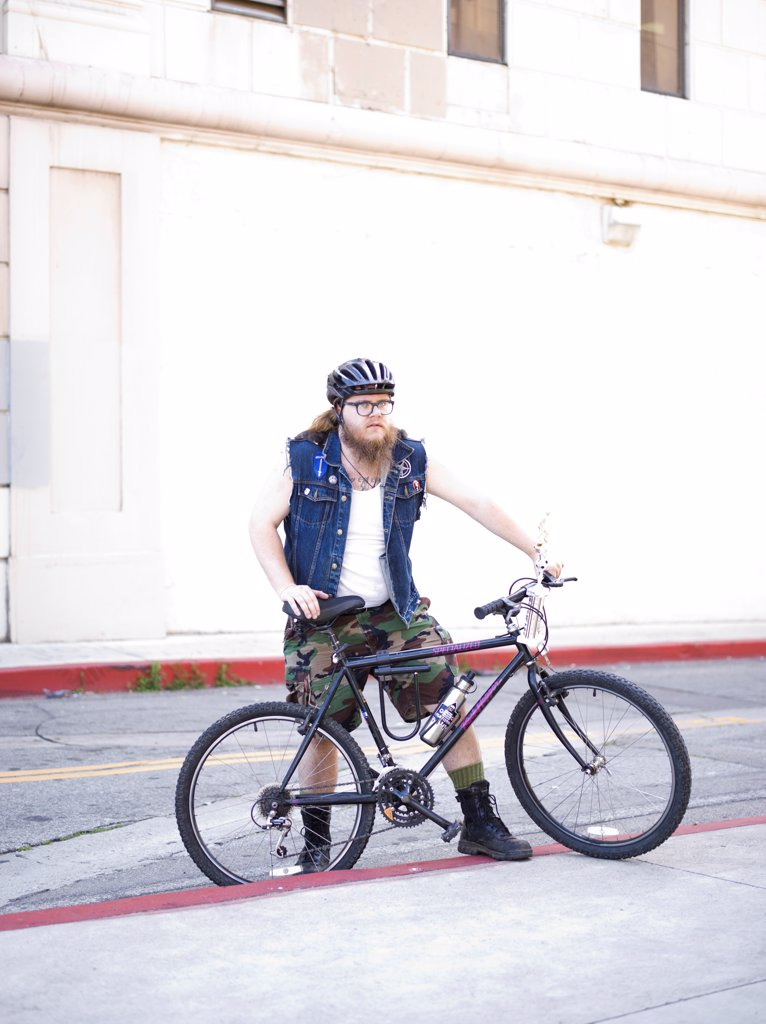 Stock Photo: 4278-9659 Man with Bicycle in City Street