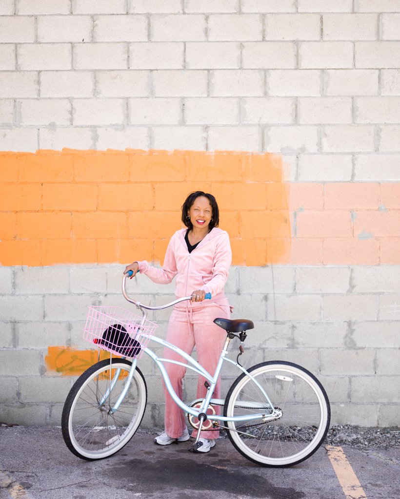 Stock Photo: 4278-9660 Woman with Bicycle in Alley