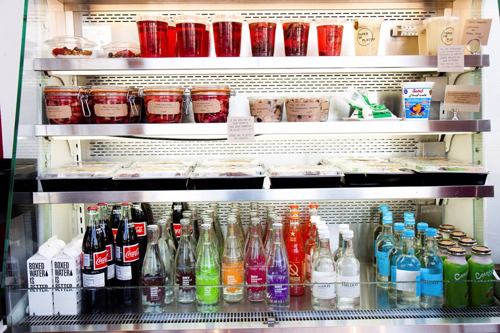 Shop Refrigerator Shelves Stacked with Food Containers and Soft Drink Bottles : Stock Photo