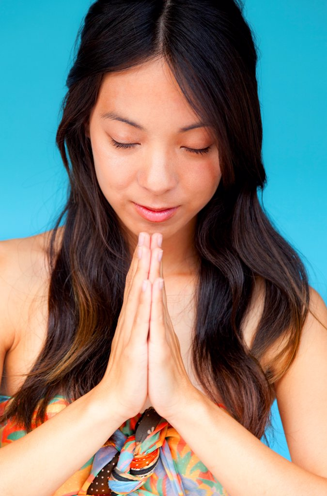 Young Woman with Hands in the Prayer Position : Stock Photo