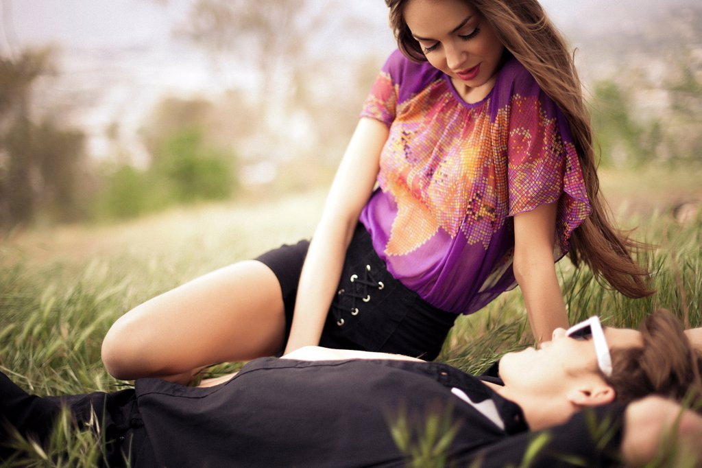 Young Couple In a Meadow : Stock Photo