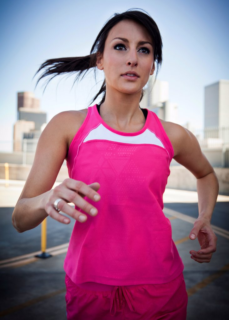 Stock Photo: 4278-9693 Young Woman Running Outdoors