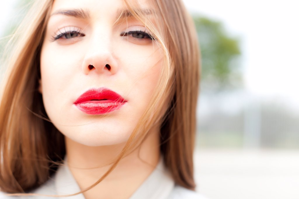 Close up of Young Woman Wearing Red Lipstick : Stock Photo