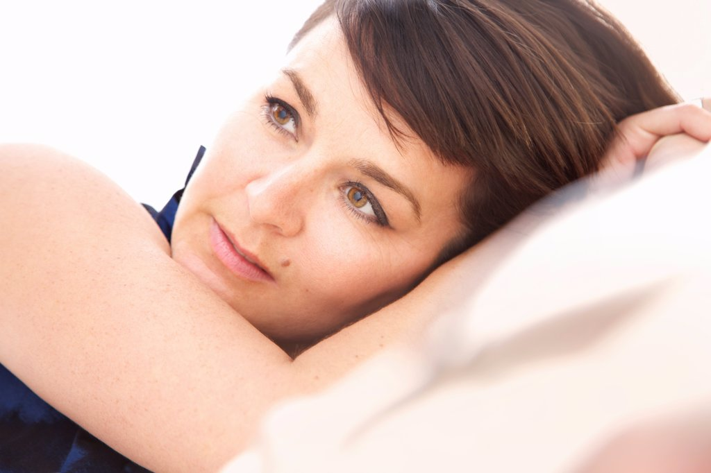 Close up Portrait of Woman Lying on Side : Stock Photo