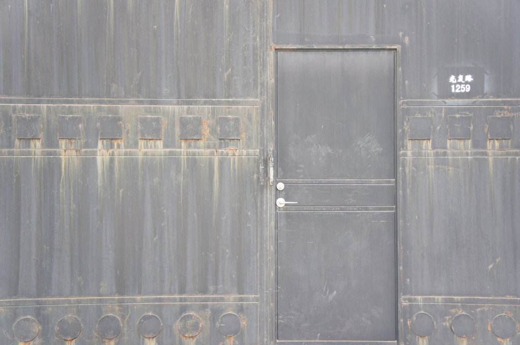 Stock Photo: 4278-9727 Closed Door on Gray Building in China