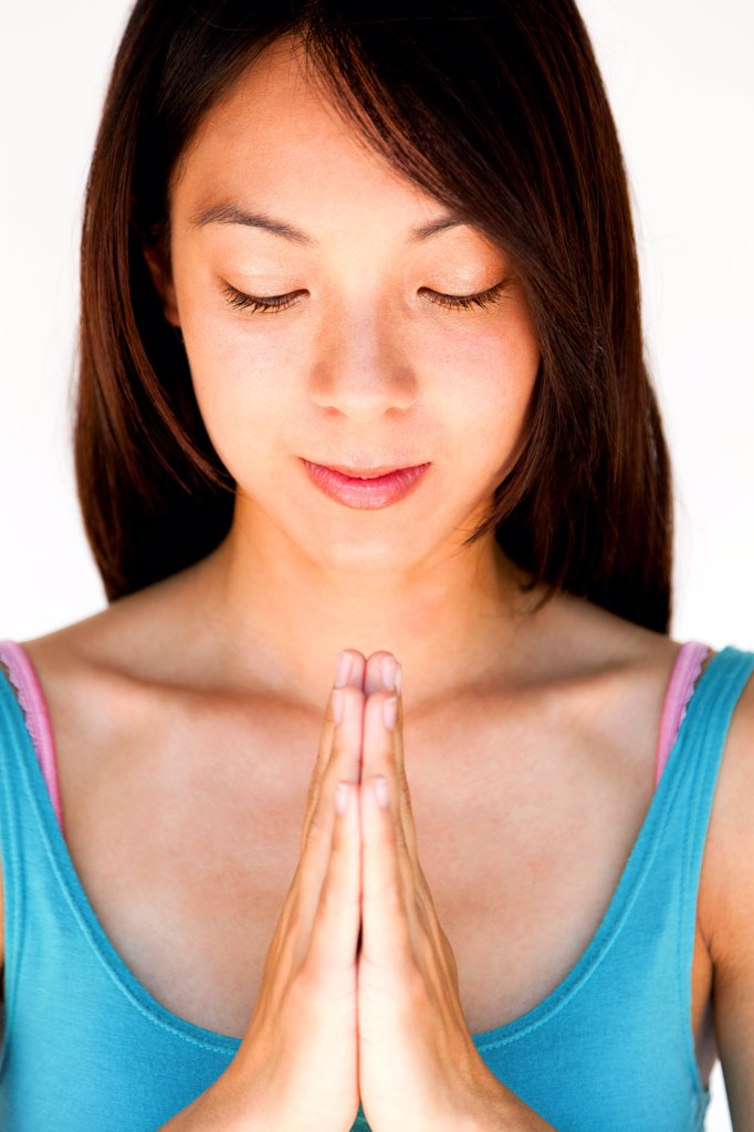 Stock Photo: 4278-9737 Young Woman with Hands in the Prayer Position