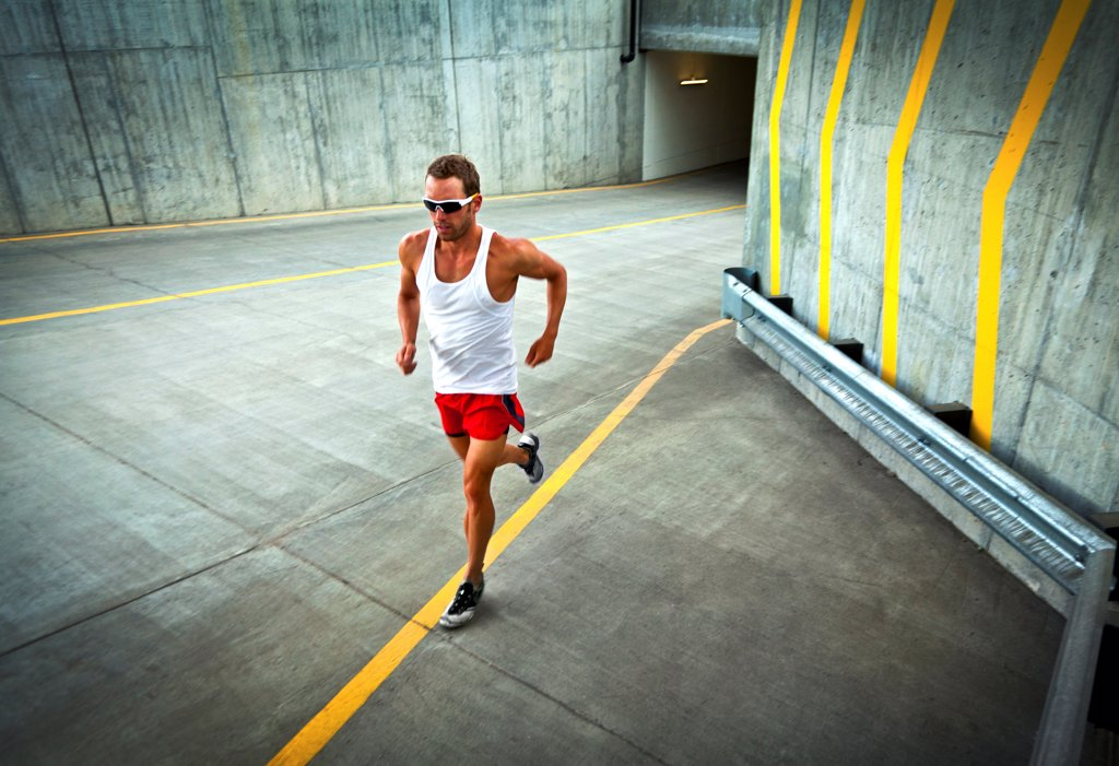 Man Running on Urban Road : Stock Photo