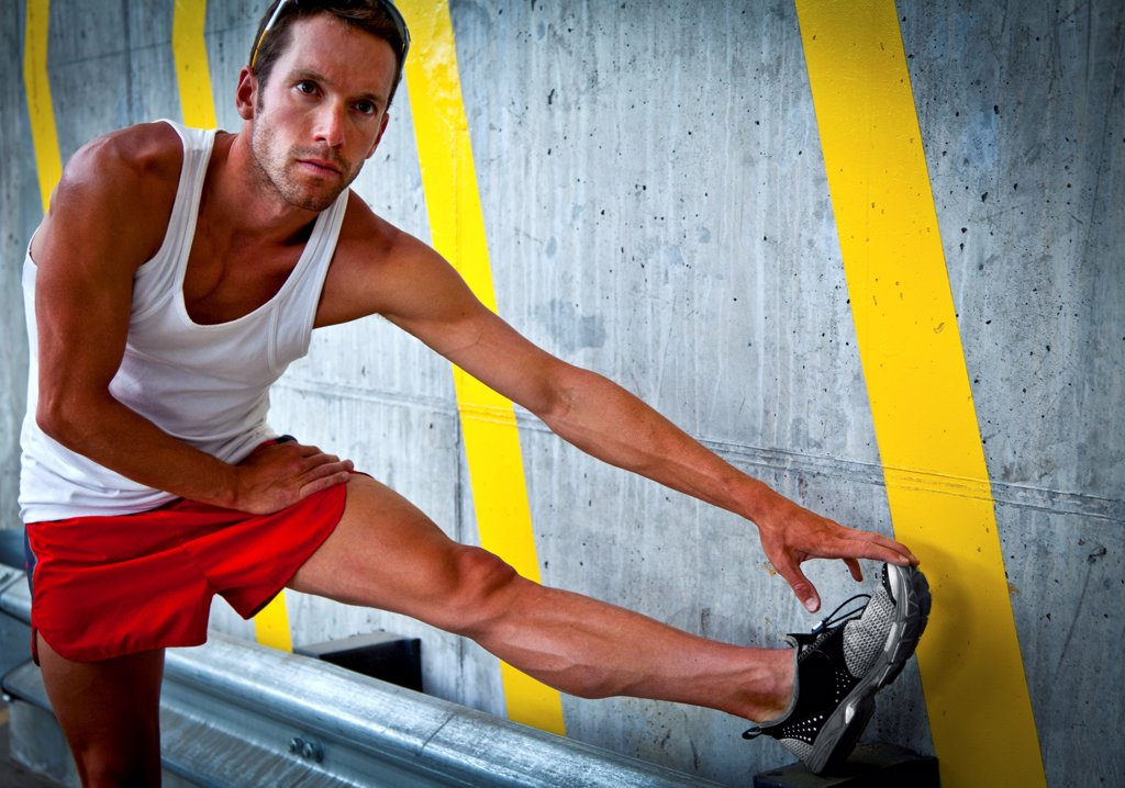 Stock Photo: 4278-9760 Sportsman Stretching his Leg