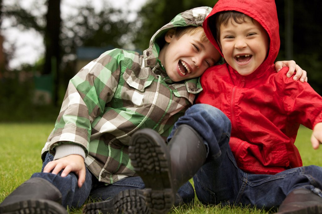 Two Boys Laughing Outdoors : Stock Photo