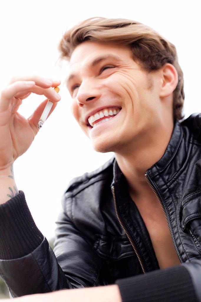 Stock Photo: 4278-9769 Smiling Man Smoking Cigarette