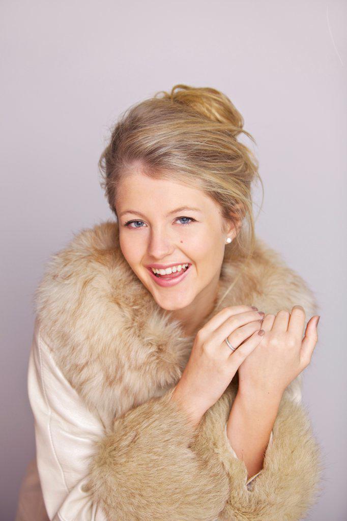 Smiling Woman in Fur Trim Coat : Stock Photo