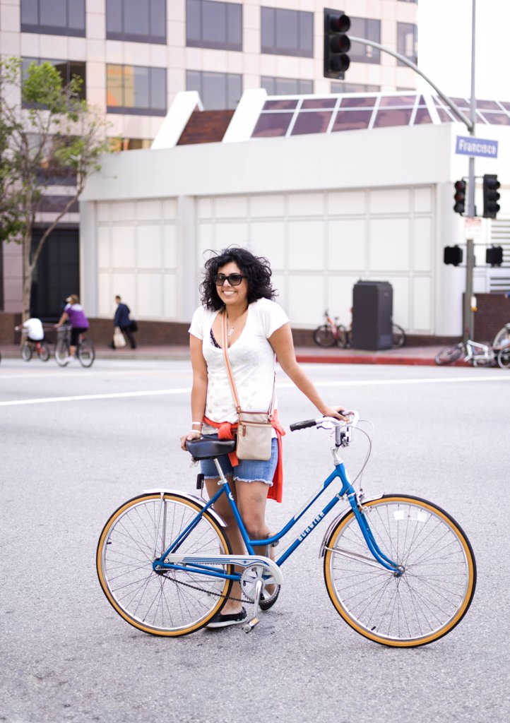 Stock Photo: 4278-9775 Woman with Bicycle in City Street