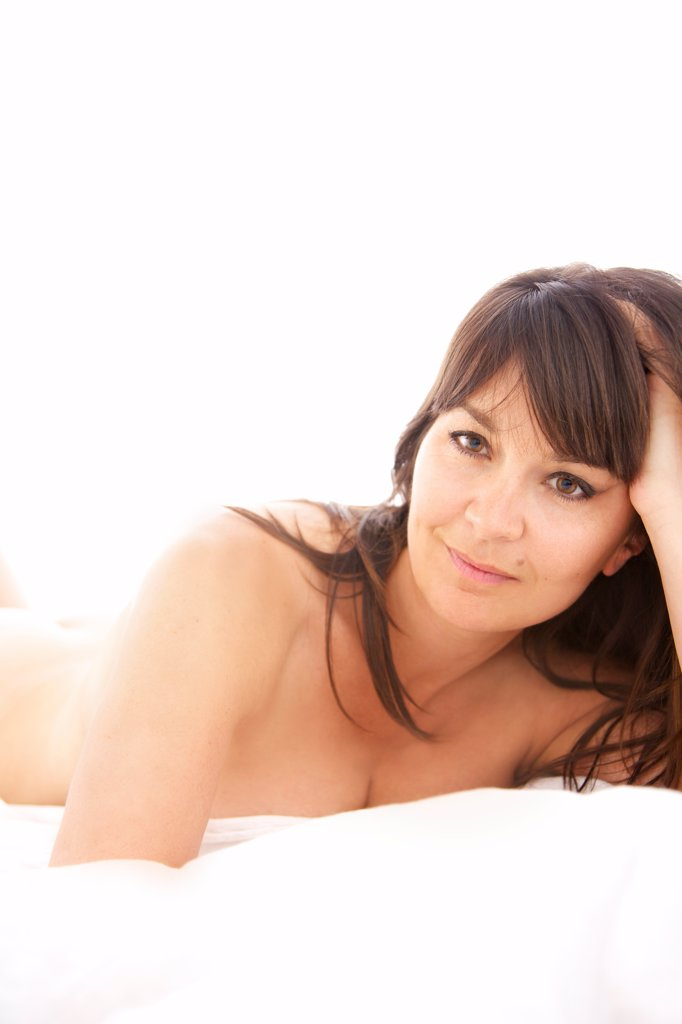 Stock Photo: 4278-9776 Woman Lying on Bed