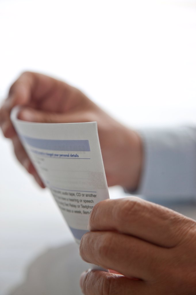 Stock Photo: 4278-9804 Man's Hands Holding Document