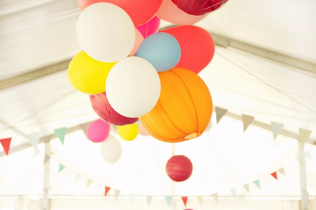 Paper Lanterns and Party Balloons Floating Inside a Marquee : Stock Photo