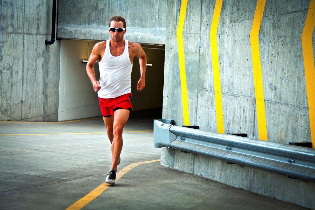 Stock Photo: 4278-9814 Man Running on Urban Road