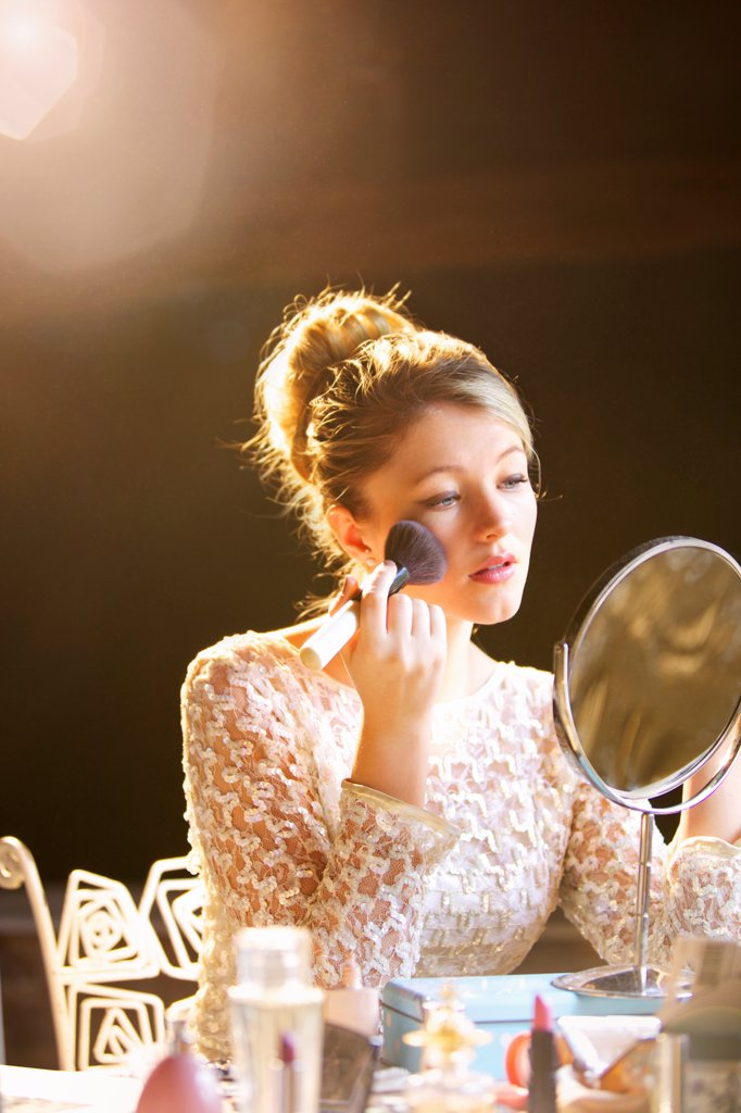 Young Woman Applying Blush : Stock Photo