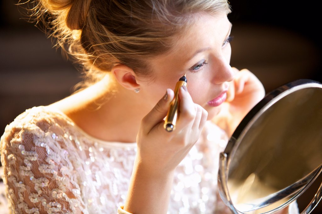 Young Woman Applying Concealer : Stock Photo