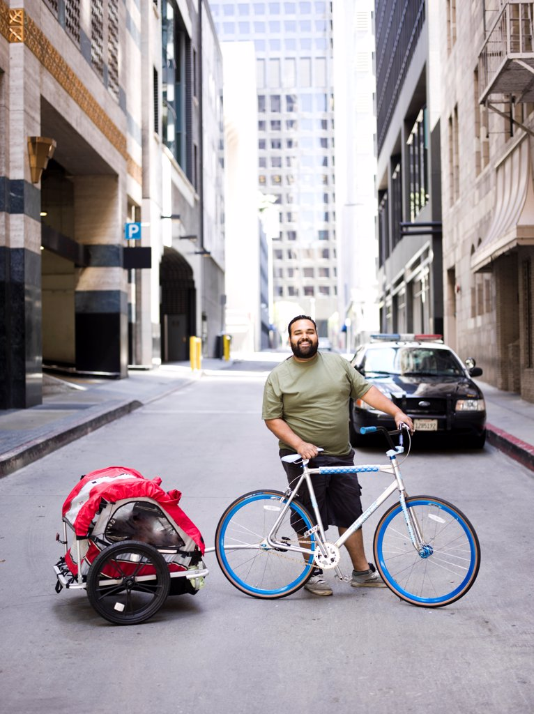 Man with Bicycle and Trailer : Stock Photo