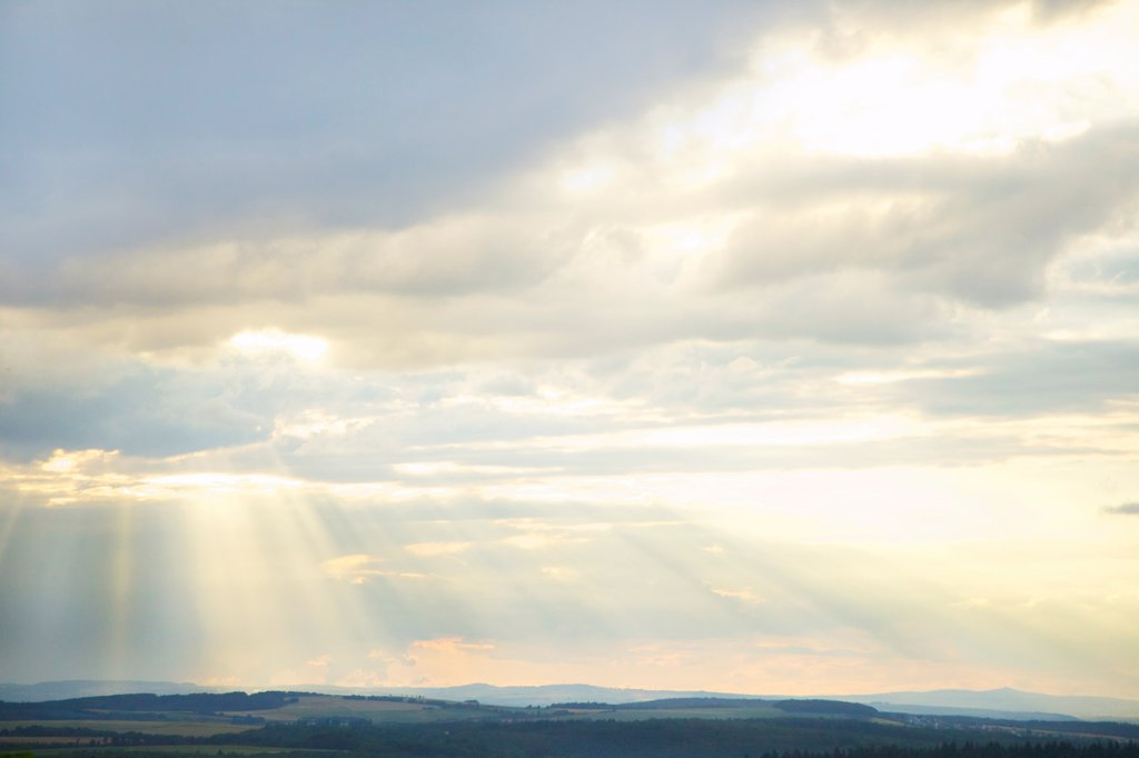 Sunbeams through Clouds over Rural Landscape : Stock Photo