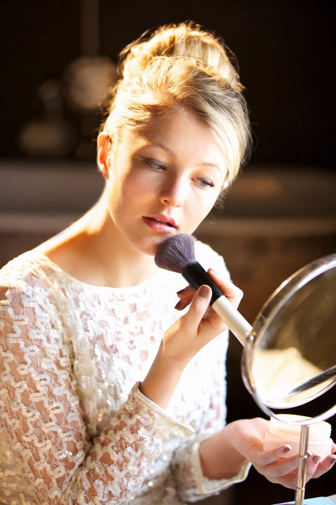 Stock Photo: 4278-9856 Young Woman Applying Blush