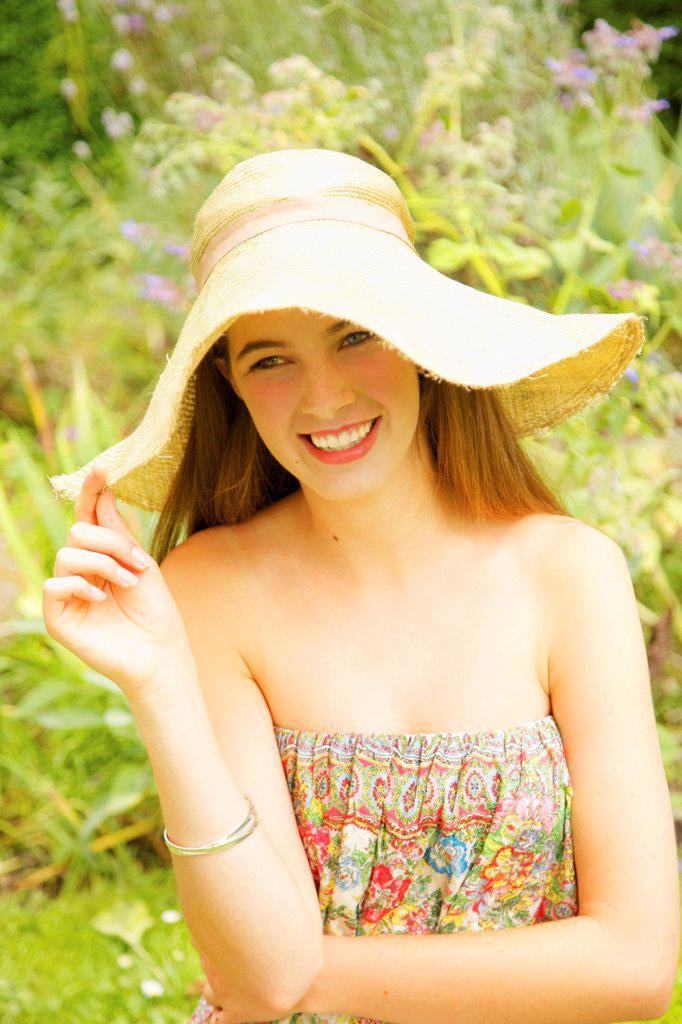 Smiling Teenage Girl Wearing Straw Hat : Stock Photo