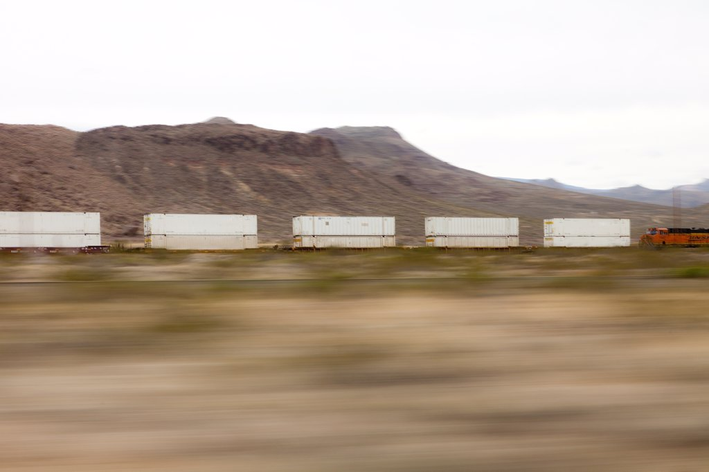 Mountain Landscape and Freight Train, Blurred Motion : Stock Photo