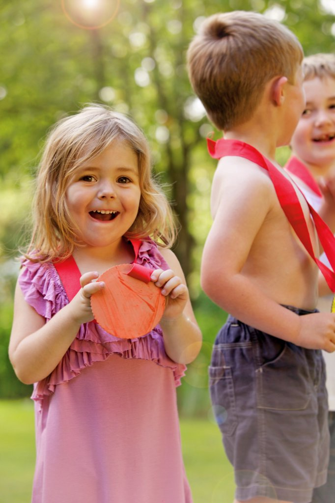 Stock Photo: 4278-9876 Smiling Young Girl with Cardboard Medal
