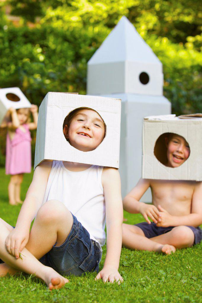 Stock Photo: 4278-9877 Boys Wearing Homemade Cardboard Helmets