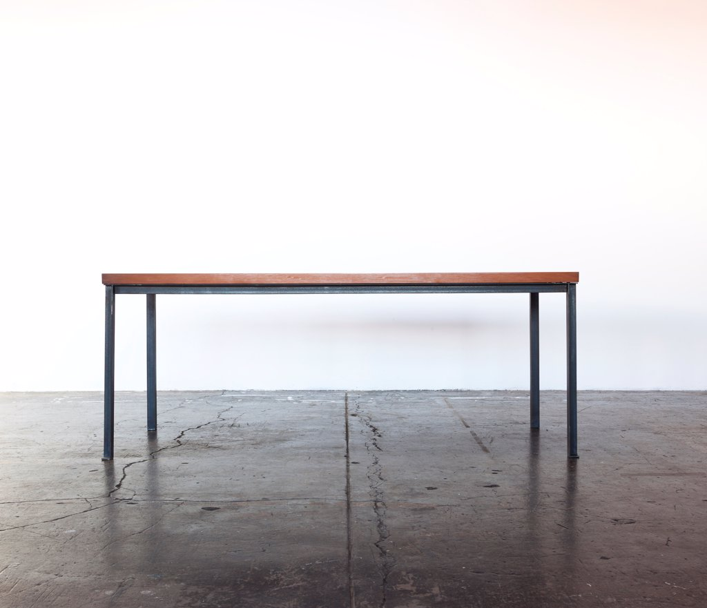 Stock Photo: 4278-9890 Iron Frame Wooden Table on Concrete Floor