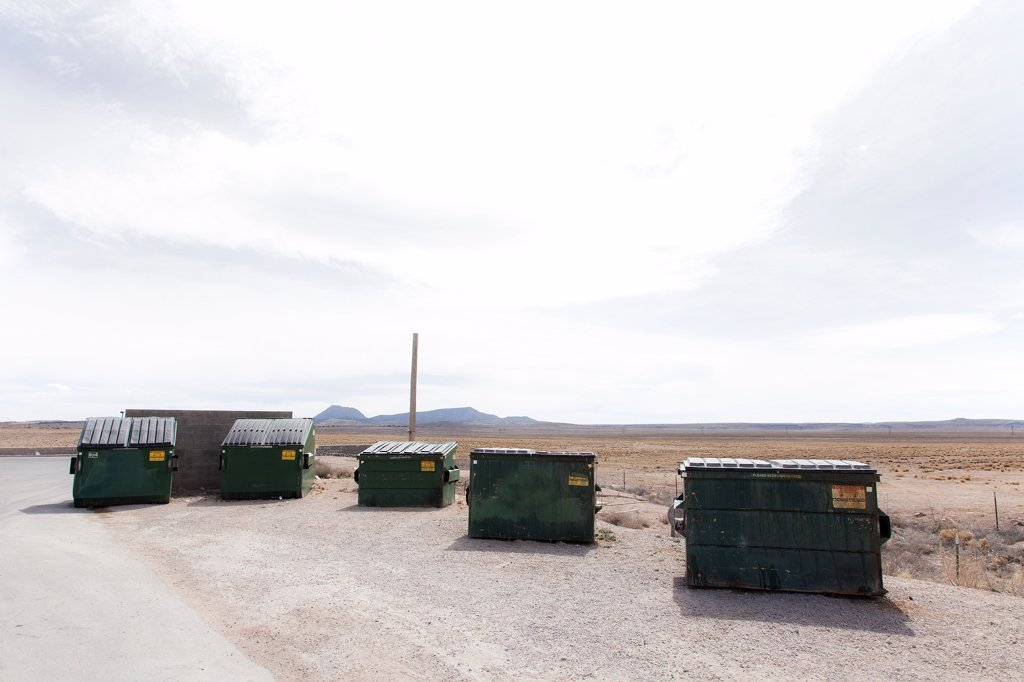 Stock Photo: 4278-9891 Waste Disposal Containers in the Desert