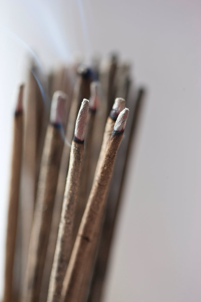 Stock Photo: 4278-9895 Bunch of Burning Incense Sticks