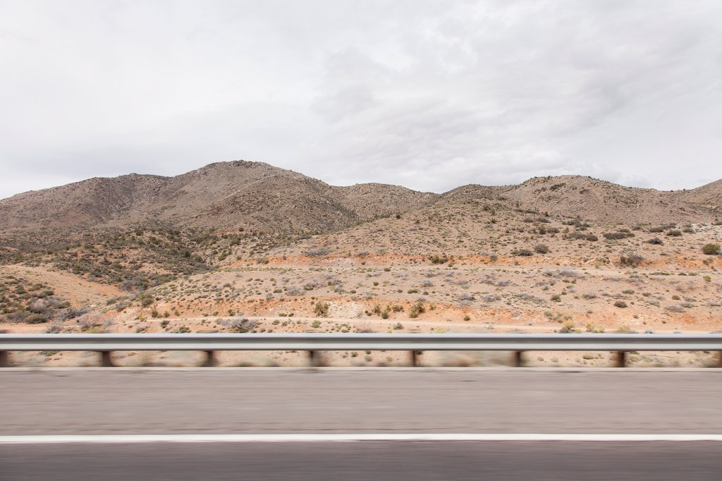 Stock Photo: 4278-9906 Highway and Mountain Landscape, Blurred Motion