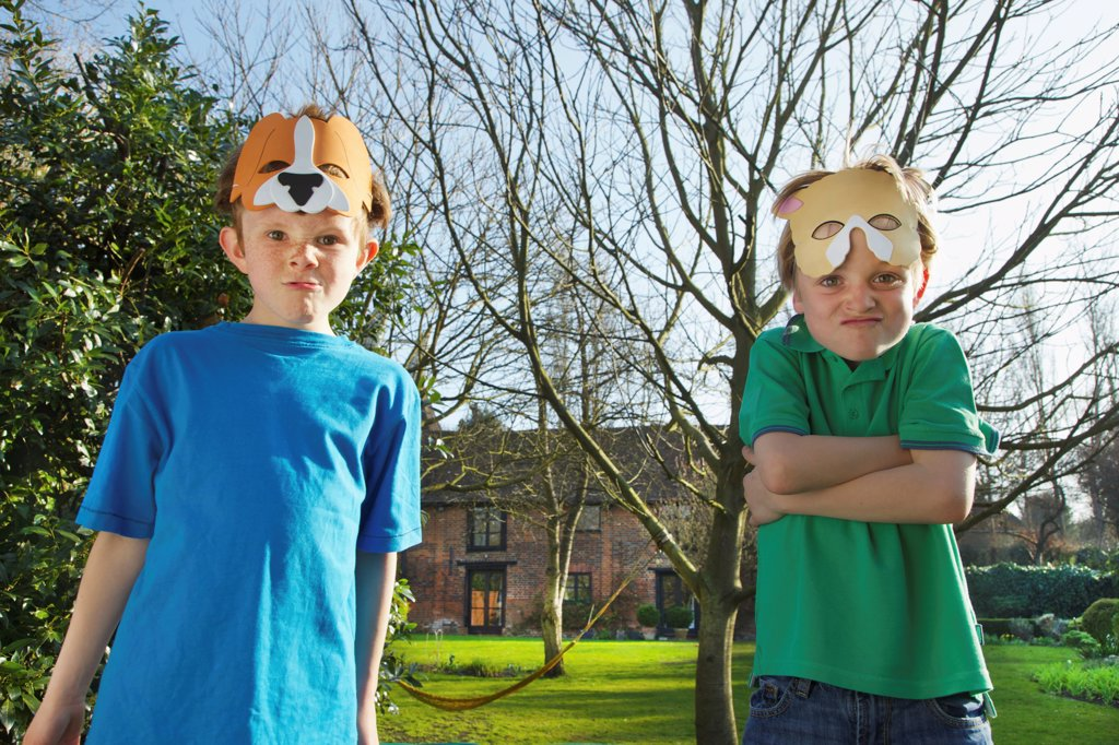 Two Boys with Masks  on Forehead Making Funny Faces : Stock Photo