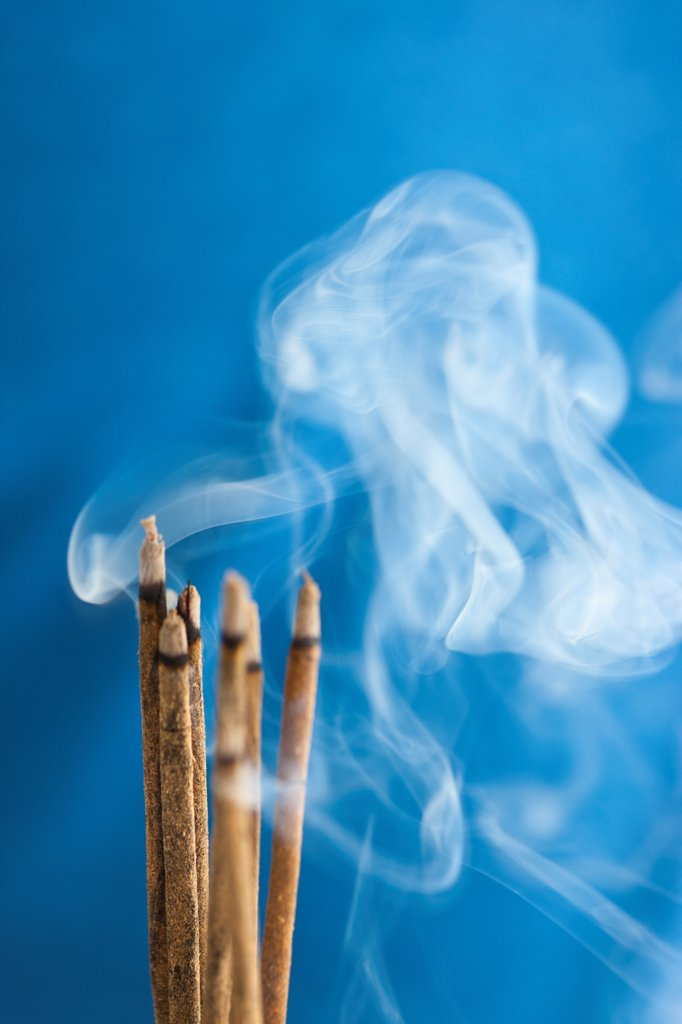Stock Photo: 4278-9927 Bunch of Burning Incense Sticks