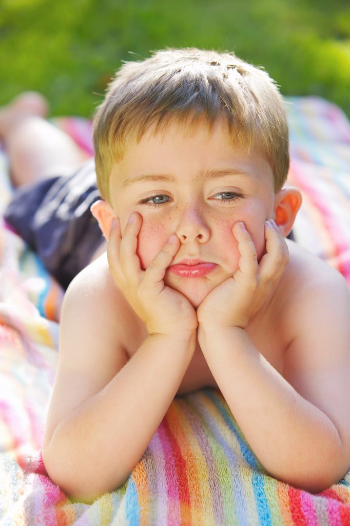 Young Boy with Hands on Chin : Stock Photo
